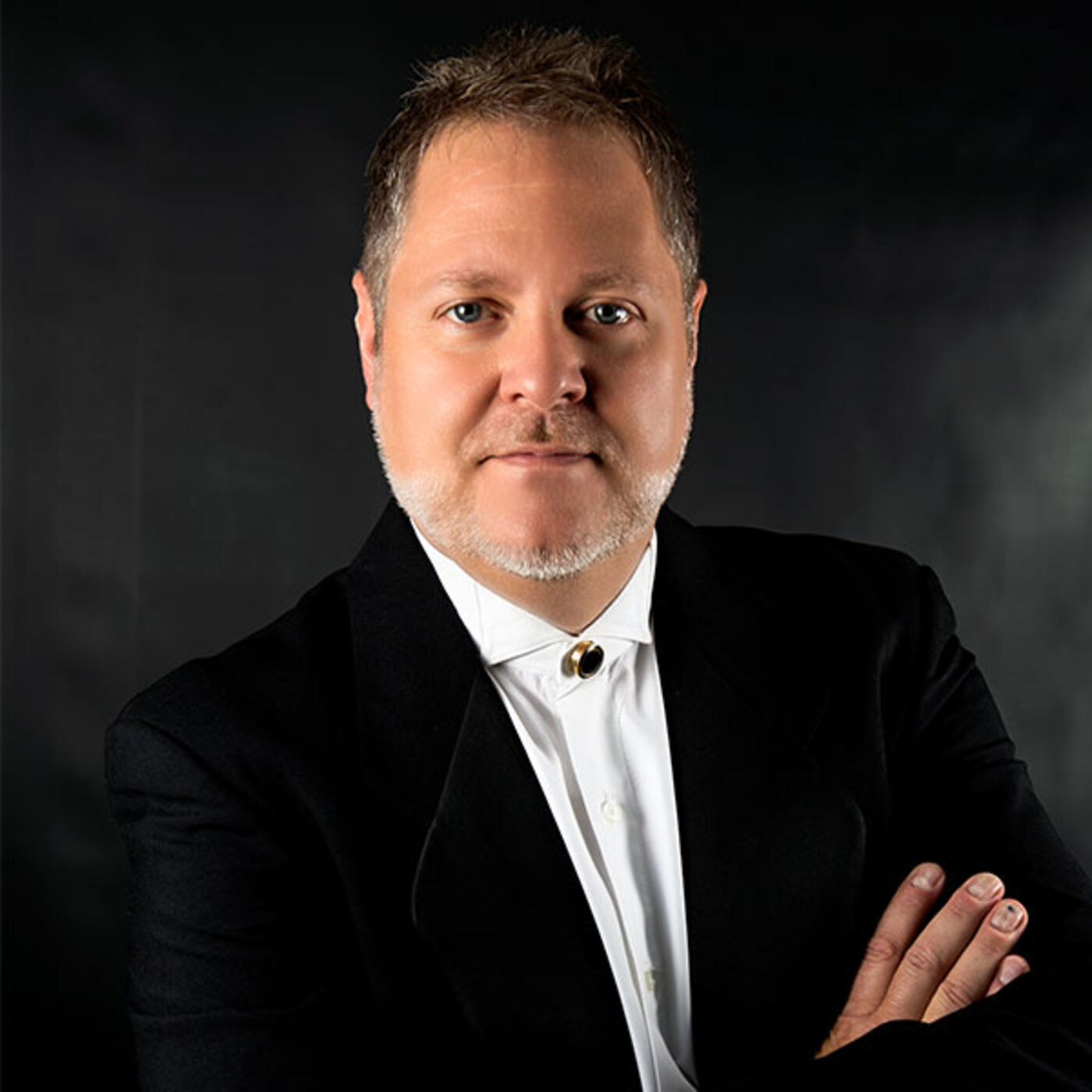 Joseph Caulkins, Conductor and Artistic Director of Key Chorale, Joins the Club